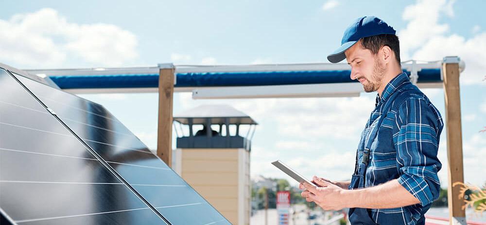 team RCR installing solar panel holding a tab
