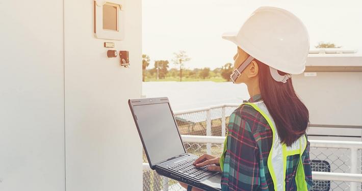 technician holding a laptop