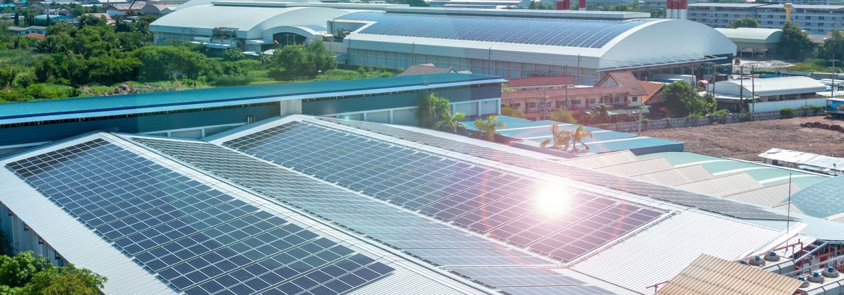 Architectural detail of metal roofing on commercial construction Solar panels or Solar cells on factory rooftop or terrace with sun light, Industry.